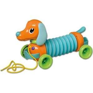 Музыкальная каталка Tomy на веревочке Щенок Марли Гармошка (ТО72098) tomy bath друзья дельфины e6528